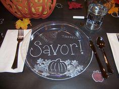 Glass plates on a chalkboard background.