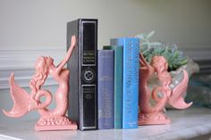 Cast iron mermaid bookends (in custom colors!) from beautifuldetailswed on Etsy