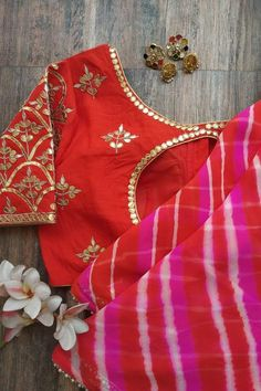 Pink Red Leheriya Saree in Pure Georgette Combined with intricate handwork gota patti blouse Beaded lace border all-over the Saree Traditional Blouse Designs, Stylish Blouse Design, Sari Blouse Designs, Fancy Blouse Designs, Blouse Patterns, Traditional Dresses, Gota Patti Saree, Pure Georgette Sarees, Embroidery Suits