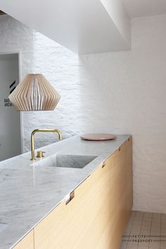 So clean. One surface. Brass faucet. Morgan doesn't want wood that light though