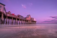 Moonrise over the pier by Cynthia Farr-Weinfeld.