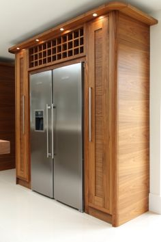 Tall pull-out storage and wine rack surround the Liebherr side by side fridge… Walnut Kitchen, Barn Kitchen, Kitchen Family Rooms, Modern Kitchen Cabinets, Kitchen Redo, Fridge Built In, American Fridge Freezers, American Fridge Freezer Built In, Refrigerator Cabinet