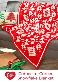 Corner-to-Corner Snowflake Blanket Free Crochet Pattern in Red Heart Yarns -- Create this beauty and use it for the holidays and every cool day throughout the year. It is crocheted in a diagonal direction starting a one corner and ending at the opposite corner. It's perfect for both modern and more traditional living areas.