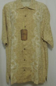 This shirt is great for casual Friday or for weekend wear. 100% silk...and super soft. Tan and cream camp hawaiian shirt. Great for any Tommy Bahama lover!