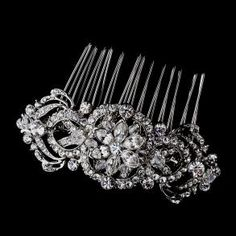 Elegance, beauty and grace! This stunning vintage inspired hair comb features a wonderful collection of sparkling clear crystals and dazzling clear Swarovski crystal beads set in gorgeous antique silver plating.