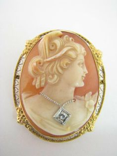 Carved Shell Cameo Pendant/Brooch Of A Woman Wearing A Diamond Brooch, Mounted In 14k Yellow Gold Filigree Frame