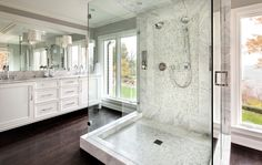 Inspired Dark Hardwood Floors trend Milwaukee Transitional Bathroom Inspiration with double sinks glass shower lake house lake view marble shower natural light wall mirror