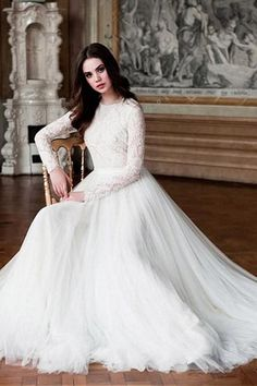 This is a made-to-order product. Designed in the most effortless silhouette, this modest wedding dress with soft tulle is breezy and easy-to-wear! A style beachy brides have been dreaming of, this relaxed wedding dress is made of romantic lace and soft tu Relaxed Wedding Dress, Dream Wedding Dresses, Mormon Wedding Dresses, Winter Wedding Dresses, Modest Dresses, Trendy Dresses, Modest Wedding Dresses With Sleeves, Event Dresses, Fashion Dresses