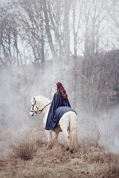 Daliah Pferd reitend