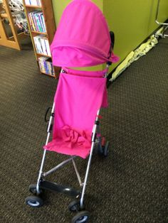 Pink Umbrella Stroller | Light weight pink umbrella stroller with canopy.   Make sure to click the link below to see more great merchandise in store now!  | LilyPads - Lincoln , NE