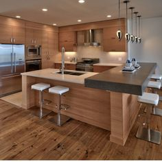 wood with light counter, floor, an backsplash