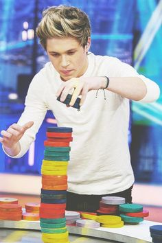 Niall Horan looking adorable while stacking checkers Lol