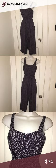 "SugarHill Boutique Jumpsuit Navy/wht cropped Sz 2 OMG! This sleeveless cropped jumpsuit/Playsuit is perfect for spring!  Wear it alone or pair with a jean jacket or light cardigan for a little bit of lovely! I think it would be great with a yellow or orange shoe and a dope hat.  It buttons down the front, has a tie waist and...pockets!   Size is 2 and measurements are as follows: Bust 34"" Waist is adjustable up to about 32""  and inseam is 20"". Length is 48"" SugarHill Boutique Other"