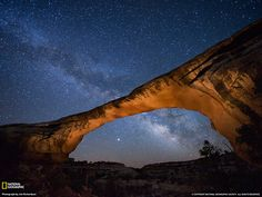"""Owachomo Bridge, Utah, 37° 36′ 4.98″ N, 110° 0′ 49.48″ W  A starry night gleams above Owachomo Bridge in Utah's Natural Bridges National Monument named the first Dark Sky Park by the International Dark-Sky Association (IDA). """"Here you see something forgotten,"""" says ranger Scott Ryan, """"and reconnect with the sky."""""""