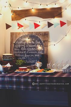rustic arrow theme baby shower - love the framed chalkboard on the food table for writing a message or the menu
