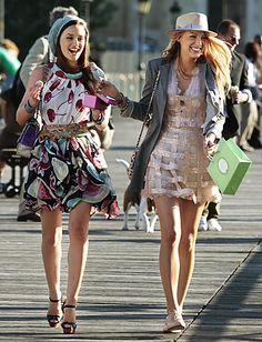 Blair Waldorf (Leighton Meester) wears a Moschino dress, Christian Louboutin shoes and Chanel cuff and bag.  Serena van der Woodsen (Blake Lively) wears a Georges Chakra dress, Rag & Bone blazer, Yestdat hat, Mulberry bag, Janis Savit bracelet and Made Her Think bracelet.