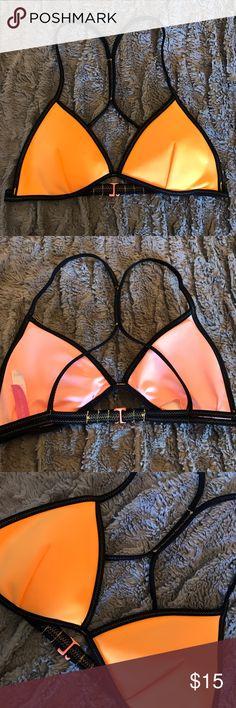 Victoria secret Bright orange bikini top Cute sporty bikini top . Has the pads still in it. Maybe worn one time Victoria's Secret Swim