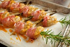 Grilled Shrimp Wrapped with Prosciutto on Rosemary Skewers