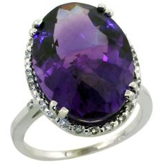 Large Halo Amethyst Ring - An amazingly beautiful 10.40 carat Large Halo Amethyst Ring stamped in 10k White Gold. It features an Incredible 10.3 Carat Oval Cut Stone atop the ring. It also has lovely 0.103 Carat Brilliant Cut accent diamonds around the stone. The ring measures 18x13mm & all of the diamonds are 100% natural, not enhanced, nor heat-treated.
