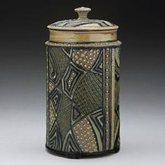 """Insomnia Pottery by Ginger Steele. """"Inspired by the beautiful surfaces and subtle colors of salt-fired pottery, I built my own salt kiln in 2004. After ten years of creating highly decorated red earthenware pottery, I wanted to bring a quieter and more abstract sensibility to the work."""" Carved Jar $ 160 - Sold 13"""" tall x 6"""" wide"""