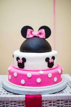Minnie Mouse birthday party cake! See more party planning ideas at CatchMyParty.com!