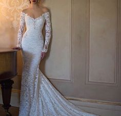 Lacy, tight fitting wedding dress with sleeves
