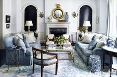 The symmetrical furniture arrangement in this Manhattan Living Room emphasizes the elegant formality of the space