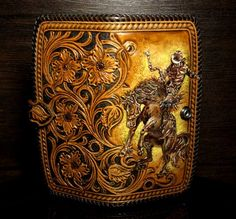 Gorgeous hand-tooled cowboy wallet with classic cheridan floral pattern and cowboy. High quality vegetable tanned leather. Braided with natural leather lace dark brown color. Inside - 2 roomy compartments for banknotes , one zip compartment and 10 pockets for cards. Comfortable Leather Carving, Leather Tooling, Tooled Leather, Tandy Leather, Leather And Lace, Leather Gifts, Leather Bags, Leather Craft Tools, Handmade Wallets