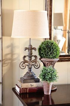 Tuscan end table with topiary, books, and a tuscan lamp! Tuscan Design, Tuscan Style, Burlap Lampshade, Tuscany Decor, Table Decor Living Room, World Decor, Tuscan House, Mediterranean Home Decor, Tuscan Decorating