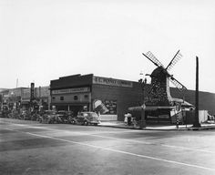 - View of a business area in Wilmington. Photo shows Van de Kamp's Bakery at the corner of Avalon Boulevard and West I Street. Other businesses includes: J. Cut Rate store and Karl's Shoes. Restaurant Photos, Vintage Restaurant, Old Pictures, Old Photos, Wilmington California, Windy Corner, Harbor City, Old Building, Historical Society