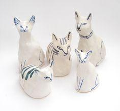 Meet the gang. Ceramic cats by Kaye Blegvad.