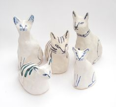 Meet the gang. Ceramic cats by Kaye Blegvad.