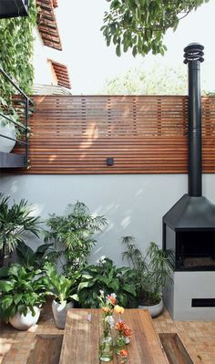 outdoor fireplace but its the fencing/trellis I like!