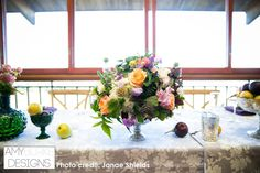 Low centerpiece for the head table with pears and apples embellishments in vases and directly on the table. @janaeshields #reception Location Thomas Fogarty Winery