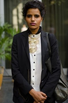 Wow, she is seriously beautiful.  She works the collar necklace over a fully buttoned shirt so perfectly here.