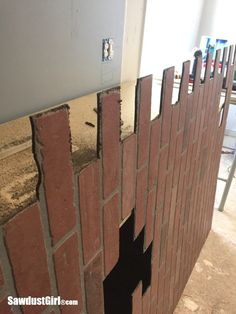 Create a cool faux brick and plaster wall by applying joint compound to easy to install, faux brick panel sheets from the home improvement store. Faux Brick Wall Panels, Brick Wall Paneling, Brick Accent Walls, Old Brick Wall, Brick And Wood, Brick Walls, Basement Wall Colors, Sawdust Girl, Old Bricks