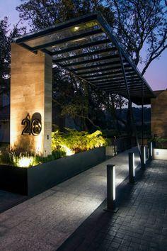 Elegant entrance canopy of the Canterburry 39 House near Mexico City by Sobrado  Ugalde