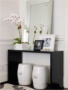 black modern console, Chinese stools via Centsational Girl
