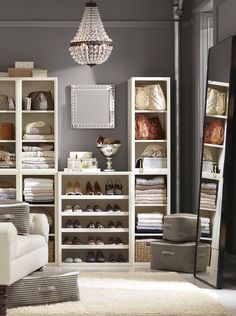 opposition: the sharp right angles that the bookcase has and the contrast of the grey and the white create opposition.