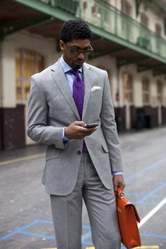 Grey suit, purple gingham shirt, and patterned tie