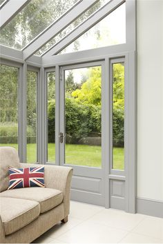 very cool - all glass sun porch including the ceiling....Farrow & Ball blackened on wall / plummet on trim