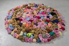 Bojagi knotted up into balls for an installation. Reminds me of french knots [Small Rotunda | Ujin Lee | springbreakartfair.com]