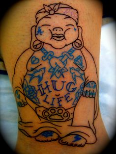 i got this tattoo for various reasons. it is not finished as yet. Im a buddhist… hence the buddha, I design tattoos for people and have a strong respect for the pioneers of the 'sailor jerry' style tattoo so thats explains the blue ink and older style mini tats. The bandana and the Hug life are a vague reference to tupac ad his epicness to the maxx. i guess what im saying is just try to enjoy your life and if you want to get covered in tattoos, thats cool… hug life. word