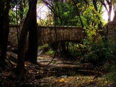 """Photo by: Carolee from Emporia Peter Pan Park in Emporia, KS, """"Stone Crossing"""" 10/17/2012: A glimpse of the stream under the bridge as it winds towards the river at Peter Pan Park in Emporia."""