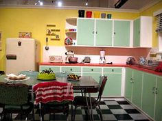 Vintage kitchen. I like the frame white and the fronts green...
