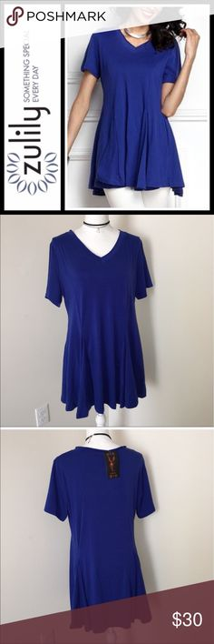 Zulily Reborn Blue Peplum short sleeve tunic NWT New with tags, from Zulily - brand is reborn - really pretty blue color! Can be worn as a dress or tunic - shoulder down is about 30 or 31 inches size is extra-large. I have multiple tops buy this brand I love them they are very flattering and super good quality! Reborn Tops Tunics