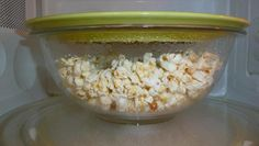 Glass bowl + ceramic plate + popcorn kernels = perfectly popped popcorn in the microwave.  No bag. No butter or oil. Nothing to throw away afterward. And even no un-popped kernels.      Take 1/4 cup of dry popcorn kernels and place in the bottom of a microwave-safe glass bowl. Place a microwave-safe plate on top of the bowl. Plate should be wide enough to go beyond the rim of the bowl.  Microwave for 2 minutes 45 seconds. Watch in glory as your popcorn pops perfectly into little puffs of heaven.