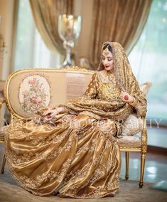 serves up yet another one of his masterpieces in a dazzling gold bridal and we must say we are obsessed! Bridal Mehndi Dresses, Bridal Dress Design, Bridal Lehenga, Bridal Style, Pakistani Wedding Outfits, Pakistani Wedding Dresses, Bridal Outfits, Nikkah Dress, Shadi Dresses