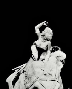 Marilyn Monroe rides a pink elephant at the Ringling Brothers Circus in a benefit performance for the Arthritis and Rheumatism Foundation, New York, March 1955