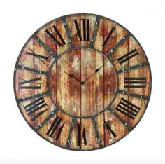 This distressed wood pallet clock features iron industrial details and roman numerals. Perfect for a traditional and elegant home and a great accent to a large